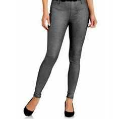 Faded Glory Black Silver Foil Jeggings Look stylish and feel comfortable in this Faded Glory Women's Full Length Knit Color Jegging. They are made of a soft and stretchy blend of cotton and spandex to fit your body and complement your shape. Silver foiled pattern over a dark black. A hidden pocket lets you store everyday essentials when you're on the go. 7% Spandex 42%cotton 51% Polyester Hidden pocket Elastic waistband Very Comfortable Faded Glory Pants Leggings