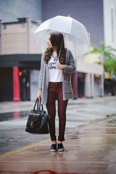 burgundy trousers, a printed tee, a grey cardigan and black slip ons