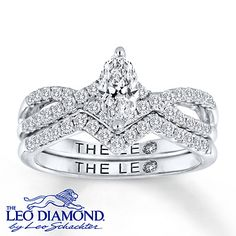 This bridal set for her features a brilliant marquise Leo Diamond as the highlight of the engagement ring. Two ribbons of round Leo Diamonds flow from the center and overlap to create an elegant band design. More round Leo Diamonds line the matching wedding band, contoured to fit perfectly against the engagement ring. The bridal set is styled in 14K white gold and has a total diamond weight of 1 carat.