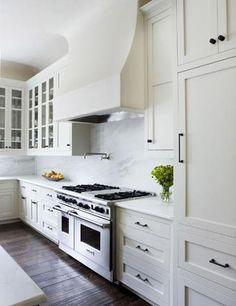Contemporary farmhouse kitchen.  Marble + walnut + white.