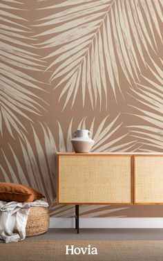 This breath-taking palm leaf wallpaper mural offers your space something a bit different from the typical brightly-colored tropical decor. This version of our Palmer design is painted in a soothing Terracotta tone that will warm up the atmosphere in your room, to create a more relaxed feel. The huge cream palm leaves are hand-illustrated with detailed pencil textures, which adds to the neutral and organic look of this wall mural.