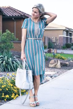 LuLaRoe Carly dress with vertical stripes. I love adding a belt to show a more defined waistline. Click to shop LuLaRoe and for more style inspiration and giveaways! (Petite styling tips for Carly dress!)