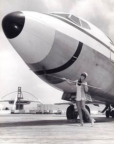Pacific Southwest Airlines stewardess, (and, apparently, a member of the ground crew as well. So efficient).