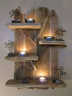 Reclaimed wood makes a nice wall piece for tea light candles