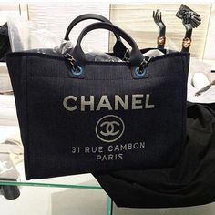 72a92b34b386 The Chanel Deauville tote bag from 2016 makes me want to take a cruise or  go on a vacation. Perfect for carrying everything you need!
