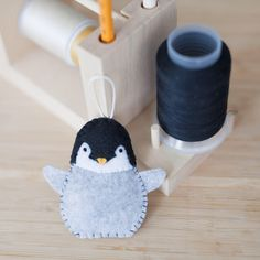 felt penguin ornament, handmade penguin ornament, decorative bird ornament, nursery decoration, home decor, baby gifts, holiday decoration by ThreadAndFelt on Etsy https://www.etsy.com/ca/listing/563944929/felt-penguin-ornament-handmade-penguin
