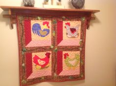 Pattern I found in a quilting magazine.  My sweet husband made the shelf and fixed it so I could hang my quilt on it.