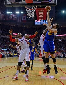 Description of . Golden State Warriors\' Andrew Bogut (12) attempts to score a basket against the Houston Rockets in the third quarter of Game 3 of the NBA Western Conference finals at Toyota Center in Houston, Texas., on Saturday, May 23, 2015. The Warriors defeated the Rockets 115-80. (Jose Carlos Fajardo/Bay Area News Group)