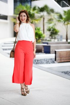Blame it on Mei Miami Fashion Blogger 2016 Summer Outfit Orange Culottes with slits Bow Top Chanel Boy Valentino Rockstud Leopard Studded Heels YSL Arty ring in Turquoise Soft Waves on Short Hair
