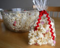 Valentine Popcorn Snack. Drizzle popcorn with melted white chocolate and sprinkle with Valentine candies.