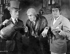 Charles Chaplin, John Barrymore and Douglas Fairbanks posing for a gag photo in 1924.  Bizarre Los Angeles.
