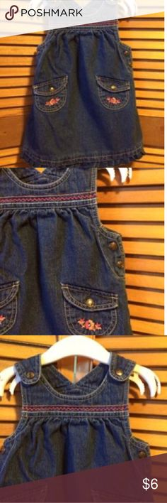 Laura Ashley Denim Jumper Denim jumper with shoulder, pocket and side snaps, ruffled bottom with embroidery at the top and on the pockets. 12 mos. Laura Ashley Dresses