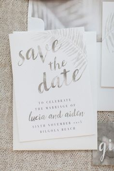 These gorgeous Save the Date cards were printed on white textured cardstock, tied up with silk, and detailed with cowrie shells. Perfect for any beach or island wedding!