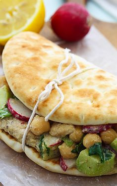 MOROCCAN CHICKEN SALAD PITAS.....also great idea for serving this type of sandwich.