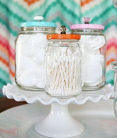 You can upcycle old jam jars as cute containers to hold small items in your bathroom.