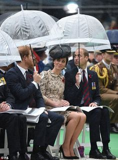 July 1, 2016. Princes William and Harry put their umbrellas up to shelter Kate as the heaven's opened during the memorial service