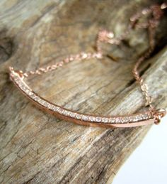 Glittering pave diamond crescent shaped bar hangs from a rose gold filled cable chain. This necklace is so feminine and pretty! Would look great
