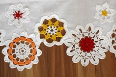 This short colorful curtain is unique window decoration. The curtain is made of cotton fabric and decorated with beautiful handmade crochet doilies. Each doily is sewn to curtain with the highest precision. The curtain dimensions in options are -width x height- respectively. Many colors