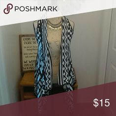 High Low Vest (M) This vest is a small funky vest.  I have worn it to the office and out with friends. No stains or tears. It is a XL but I'm normally a small or medium and it fits me. Jackets & Coats Vests