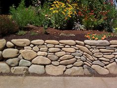 River Rock Retaining Wall   Fluid Art! Love It!