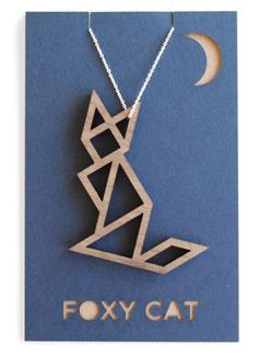 A tangram-style laser-cut necklace that looks like… a foxy cat?