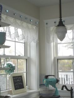 Such a charming way to hang up a valence on little glass knobs!