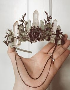 A beautiful boho crystal crown from O Wisteria with a witchy vibe. Great ideas for boho weddings or festivals! #bohobride #witchy #bohocrown #crystalcrown #rawcrystal