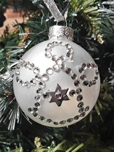 DIY Christmas tree ornament.  Clear crystal ball painted inside  with white nail polish and decorated as an angel with crystal stickers.