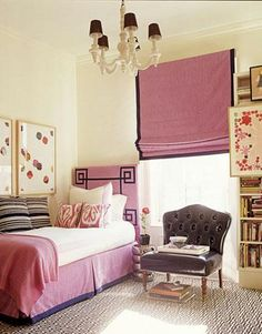 girl's rooms - pink Greek key headboard pink roman shade chocolate brown velvet border geometric brown white wool rug striped black white rug pink ikat pillows white chandelier brown leather tufted accent chair