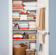 "still love this linen closet.just wish my linen ""closet"" was an actual closet with one door and not 3 separate cabinets.Use a towel rod on the inside of the linen closet for holding blankets. Linen Closet Organization, Organization Hacks, Closet Storage, Organizing Ideas, Organising, Bathroom Organization, Bathroom Storage, Smart Storage, Bathroom Towels"