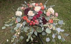Draping style centerpiece for sweetheart table. With corals, pinks, ivories and deep burgundy.