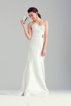 Brides.com: Wedding Dresses We Love For Under $1,500. Look long and lean (and oh-so-chic) in a clean column with an on-trend asymmetrical bodice.  Mikado fit-and-flare wedding dress, $1,200, Wtoo  See more Wtoo wedding dresses.