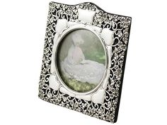 'Antique Edwardian Silver Frame' http://www.acsilver.co.uk/shop/pc/Sterling-Silver-Photograph-Frame-Antique-Edwardian-56p5983.htm