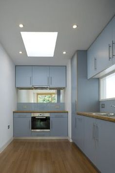 Average size kitchen room with all the the cupboards.