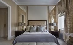 Mirrored walls on either side of bed. Helen Green - Grand House, Chelsea