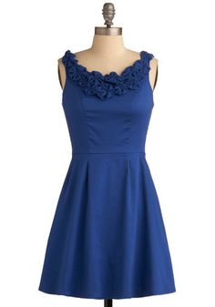 Dress from ModCloth. Take a basic a-line dress pattern (Coffee Date Dress pattern would work, just leave out the ruffle) and add fabric yo-yos around the collar on front and back. Voila!