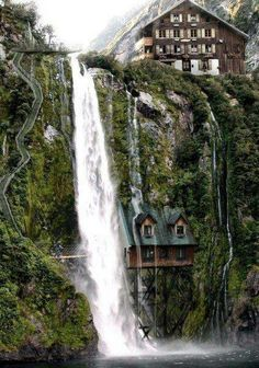 Swiss house under the waterfall