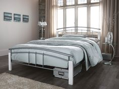Features a contemporary design with a curved top rail in both the head and foot end. Includes a sprung slatted base for extra mattress support and comfort (mattress not included). Silver Bedding, White Bedding, Stylish Beds, Comfort Mattress, Small Bedroom Designs, Guest Bed, Metal Beds, New Beds, Modern Bedroom