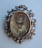Silver mourning brooch with seed pearls, and curls of hair under glass, c. mid-19th C.