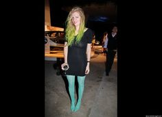 A fantastic light teal shoe and matching leopard print tights with accented neon green hair at the Ferrari party.