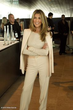 @Nina Garcia looking FABULOUS in Michael Kors.  The neutral ensemble *pops* with the added sassy, long-sleeved underneath.