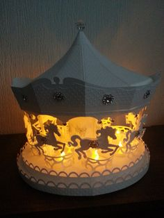 """This Carousel was made using a File from SVG CUTS which is called """"Carousel Ride"""".. this can be seen among many other photos of this on my Lolabelle Facebook Page :)"""