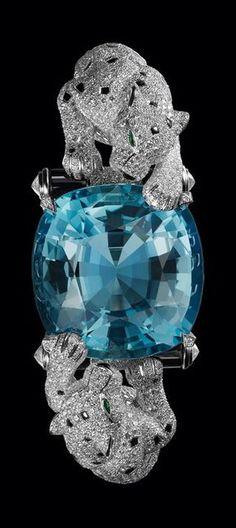Cartier ~ Bracelet en platine, onyx, yeux émeraude, diamants et une aigue-marine coussin de 65.93 carats. Nils Herrmann