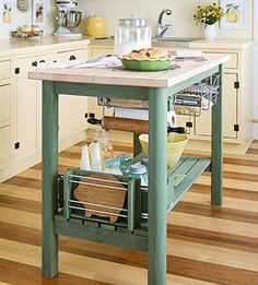 Transform a basic table into a multi-use work station by hanging wine racks and baskets under the surface to hold utensils and build a larger shelf below to hold big items like mixing bowls.  Instant kitchen island!