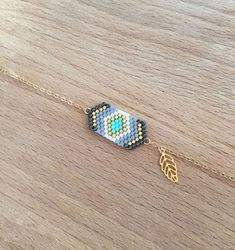 Items similar to Bracelet weaving geometric gray and small leaf gilded with fine gold on Etsy Bracelets Fins, Bead Loom Bracelets, Woven Bracelets, Beaded Jewelry Designs, Handmade Beaded Jewelry, Seed Bead Jewelry, Motifs Perler, Bead Embroidery Jewelry, Diy Schmuck