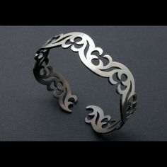 Ornamental SIlver Bangle by Janet Huddie