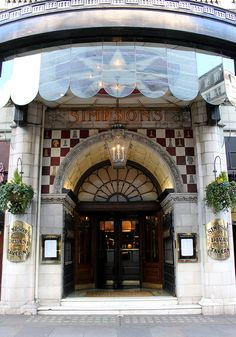 Simpson's-In-The-Strand - I love everything about this - the scalloped awning, the arch with checkered tile, the curved brass plaques on the columns...PERFECTION!!!