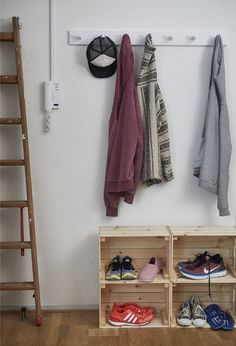 Hanging rack and crates for coats and shoes.