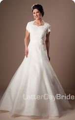 For a more modest neckline try LatterDayBride... i'm all for modest wedding dresses but this was funny.