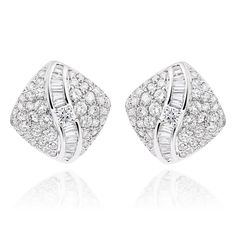 Beautifully rendered in 18-karat white gold, these stud earrings sparkle with 126 round and baguette-cut diamonds for a shimmering, gorgeous effect. The 12mm posts close with saddleback clasps.